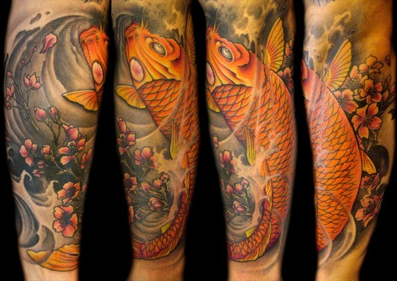 Mathew Clarke - Full color Koi fish half sleeve tattoo.